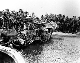 Japanese destroyer Kikuzuki (1926) - The rusting hulk of Kikuzuki, photographed on Tulagi in August 1943 after U.S. forces dragged the wreckage onto the beach.