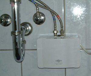 Tankless water heating - Electric point-of-use (POU) tankless water heater, wall-mounted under a sink (Germany)