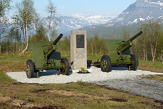 Carl Gustav Fleischer - Memorial to Fleischer and the 6th Division at Lapphaugen in Troms, Norway. The memorial stone is flanked by heavily modernized ex-German 10.5 cm leFH 16 field howitzers.