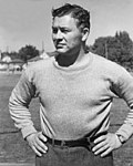A black and white photo of Curly Lambeau from the waist up