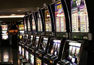 Multi-armed bandit - A row of slot machines in Las Vegas.