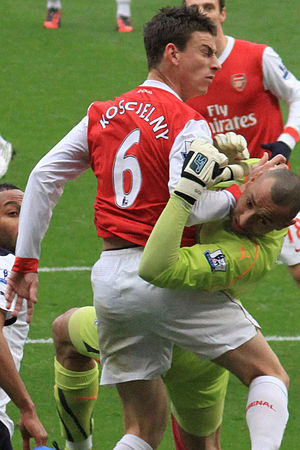 Heurelho Gomes - Gomes (in green) clashing with Arsenal defender Laurent Koscielny in a North London derby in November 2010