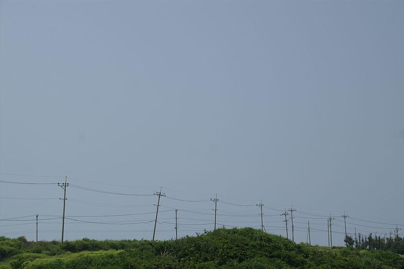 File:Leaned telegraph poles - Kohama-jima island.jpg