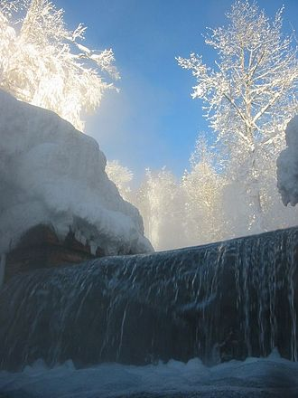 Liard River Hot Springs Provincial Park - Waterfall from Alpha Pool