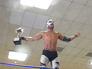Lince Dorado - Dorado in his BDK attire, holding the Young Lions Cup, before he went on to lose it to Frightmare.