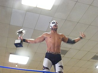 Lince Dorado - Dorado in his BDK attire, holding the Young Lions Cup, before he went on to lose it to Frightmare