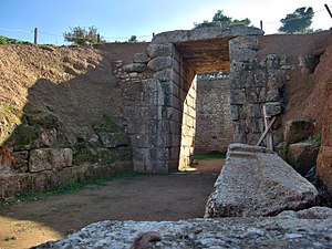 Beehive tomb - The Lion Tholos Tomb at Mycenae. Of note are the ashlar stomion (of conglomerate) and dromos while the chamber itself remains made of smaller stones, placing the tomb in Wace's second group