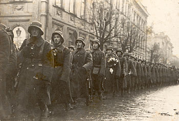 Lithuanian soldiers marching in Lithuanian cap...