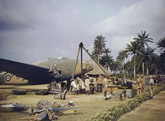 History of the Gambia - Royal Air Force fitters assisted by native helpers change the engine of a Lockheed Hudson aircraft at a West African base (probably Yundum) using an improvised hoist (1943)