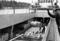 Longshoremen in loading rolls of paper in the port of Hallstavik, Sweden - 1962.png