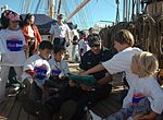 Lt. Chris Nolan Aboard The U.S. Coast Guard Cutter Eagle Reads A Story To San Francisco Children From Portola Family Connections DVIDS1088106.jpg