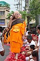 Luang Por Dattajivo walking in a procession, front view.jpg