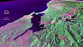 Macquarie Harbour - False colour Landsat image centred on Macquarie Harbour, looking northwest, draped over digital elevation model with x2 vertical exaggeration; screen capture from the NASA World Wind
