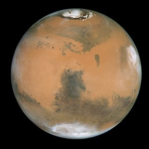 Glossary of astronomy - Syrtis Major (center) is a prominent dark albedo feature on Mars