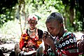 Masai woman making beaded bracelet.jpg