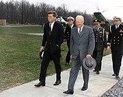 Meeting with President Eisenhower. President Kennedy, President Eisenhower, military aides. Camp David, MD. - NARA - 194198