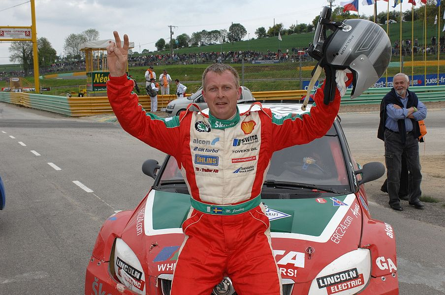 Swedish rallycross driver Michael Jernberg celebrates third place at Round 3 of the 2009 FIA European Rallycross Championship at Circuit des Ducs, France