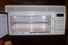 A Microwave Oven With Metal Shelf