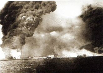 Black Sea Raid - Oil tanks in Novorossiysk harbour burn following bombardment