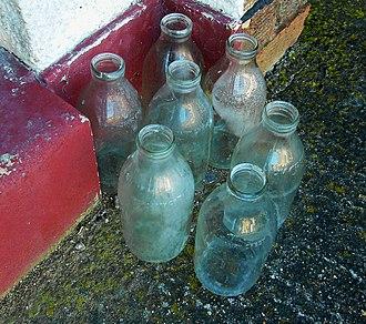 Glass milk bottle - Seven modern Dairy Crest milk bottles.