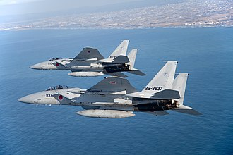 Fighter units of the Japan Air Self-Defense Force - Two F-15Js in flight; these aircraft equip seven JASDF fighter squadrons