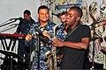 Mozambican musician Abacilar Simbine plays saxophone at the Mozambique Musicians Association Headquarters as U.S. Navy Musician 2nd Class Kori Gillis plays tambourine and Musician 2nd Class Paul Kim, back left 120609-N-UG232-393.jpg