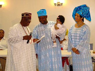 Odinani - An Igbo naming ceremony for a child of Igbuzo heritage in Washington, D.C. Parents of the child confer with the Diokpa (eldest member of the family or 'patron') on the names of the child.