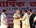 Narendra Modi being presented the traditional dress at the 85th Annual Conference of Srimanta Sankaradeva Sangha, at Sibasagar, Assam. The Minister of State for Youth Affairs and Sports (Independent Charge).jpg