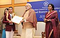 Narendra Modi presenting the National Bravery Awards 2015 to the children, in New Delhi on January 24, 2016. The Union Minister for Women and Child Development, Smt. Maneka Sanjay Gandhi is also seen (13).jpg