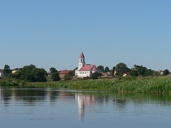 Church of Corpus Christi in Suraż seen from the Narew riverside
