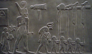 Sandal-bearer - Narmer Palette: the sandal-bearer is the first from left to right.