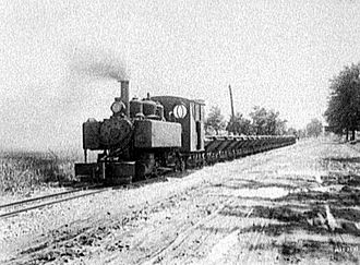 Trench railways - One of the military 2-6-2T pulling 4-wheel side dump cars for a Michigan construction project in 1921.