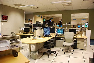 National Hurricane Center - The HSU operations area comprises four desks (pictured) from which the tropics are monitored