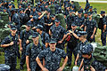 Naval Air Technical Training Center students stand by to board buses that will take them to Marine Corps Logistics Base in Albany, Ga., ahead of Hurricane Isaac in Pensacola, Fla., Aug. 27, 2012 120827-N-IM980-004.jpg