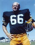 A photo of Ray Nitschke holding his helmet