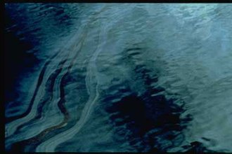 Oil Pollution Act of 1990 - Heavy sheens of oil as visible on the surface of the water in Prince William Sound following the Exxon Valdez oil spill.