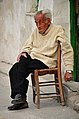 Old man sitting on traditional chair, Nicosia.jpg