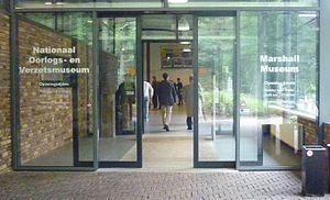 Sliding door operator - Sliding door with opener in a museum