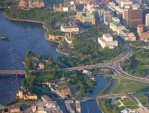 Chaudière Falls - Victoria Island, part of Chaudière Island on lower left, Ottawa mainland on right, and Parliament Hill in background