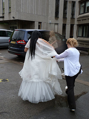 Sham marriage - Officers from the UK Border Agency lead away the would-be bride in an operation to prevent a sham marriage.