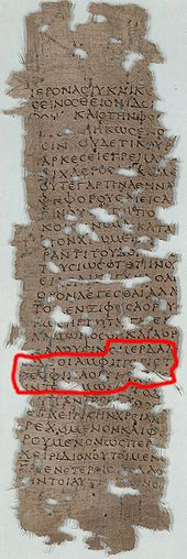 Tall, thin, and old papyrus fragment in handwritten ancient Greek, with many holes in it, and with one phrase highlighted in red for identification