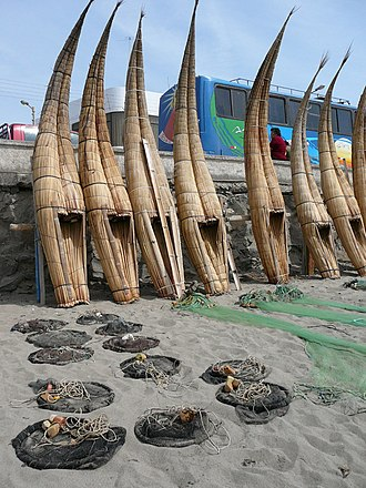 Reed boat - Totora reed fishing boats on the beach at Huanchaco, Peru