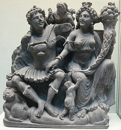 stone fragment The Buddhist gods Pancika (left) and Hariti (right), 3rd century, Takht-i Bahi