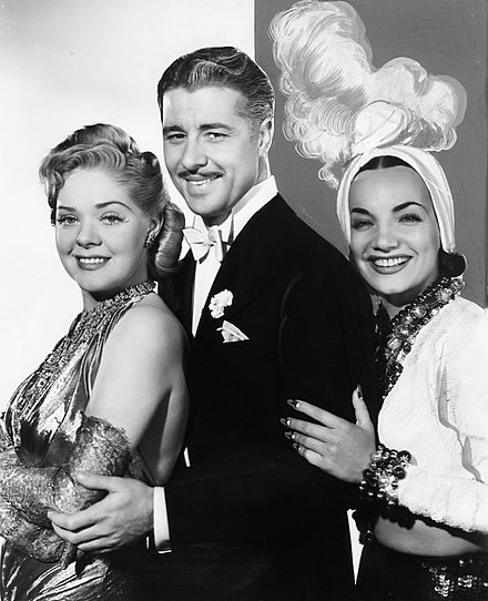 Alice Faye, Don Ameche, and Carmen Miranda in That Night in Rio, produced by Fox in 1941. Photo Don Ameche, Alice Faye, and Carmen Miranda in THAT NIGHT IN RIO (1941).jpg
