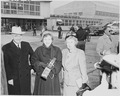 Photograph of President Truman, with Mrs. Truman and Margaret Truman at Washington National Airport, preparing to... - NARA - 200129.tif