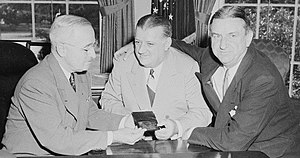 Bert Bell - Bell (center) with Washington Redskins owner George Marshall (right) presenting President Harry Truman an annual pass to NFL games in 1949.