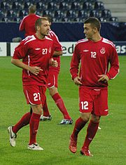 Players of Hapoel Tel Aviv, Victor Maree (12) & Romain Rocchi (27).jpg