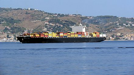 A cargo ship cruises towards the Strait of Messina Portacontainer MSC in navigazione nello stretto di Messina.jpg