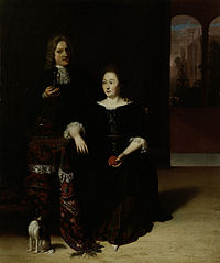 Portrait of a woman and a man in an interior