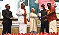 Pranab Mukherjee presenting the Rajat Kamal Award to the Audiographer Shri Ajith Abraham George for the Best Audiography, In Return Just A Book, in Non-Feature Film Section, at the 64th National Film Awards Function.jpg